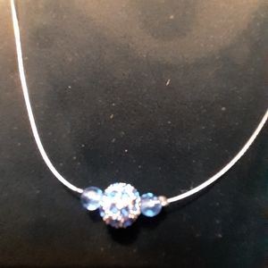 Blue & Silver Bead floating on Silvertone Wire